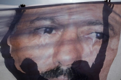 Protesters defaced a poster of Saleh at a rally outside Sana'a University last week [Reuters]